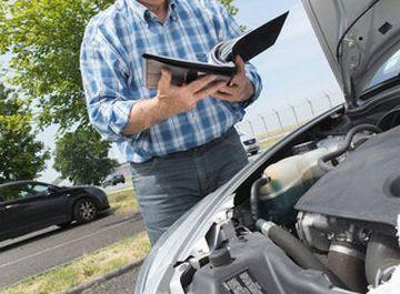 man-using-vehicle-checklist-adobe-stock